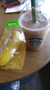 dark chocolate, with chocolate chips, banana and ice cream drink with another banana on the side.