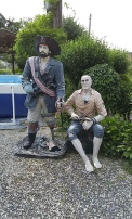 pirate statues at the entrance to the pension