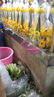 flowers for shrines I think and the tiniest pineapples ever