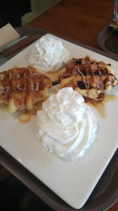 waffles with honey, whipped cream and chocolate