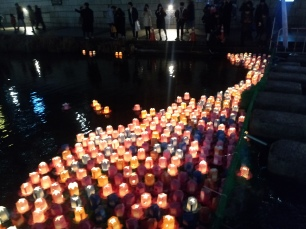 There is a section of the stream where you can get a lantern, light it and send it off a short bit to join the rest of these lanterns that are stuck. Not sure if it costs money or how much. (but have some cash if you're interested)
