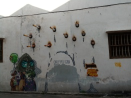 """""""Burning"""" by graffiti artist Cloakwork, the original piece stated """"Only You Can Stop Air Pollution"""" but it seems to have been smoked over."""