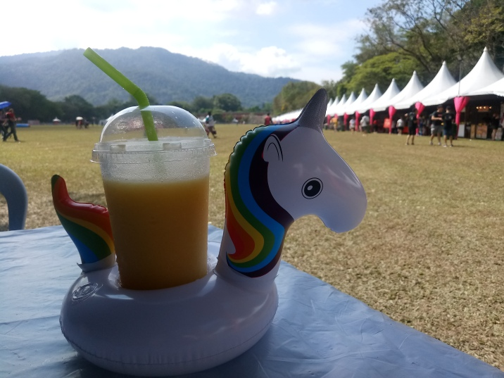 mango smoothie in a unicorn floaty (12RM)