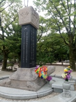 A turtle and statue in honor of Koreans who'd died during the bombing