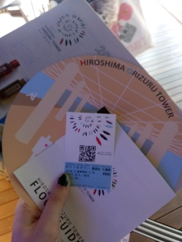 Our tickets, guides to the museum, and a fan