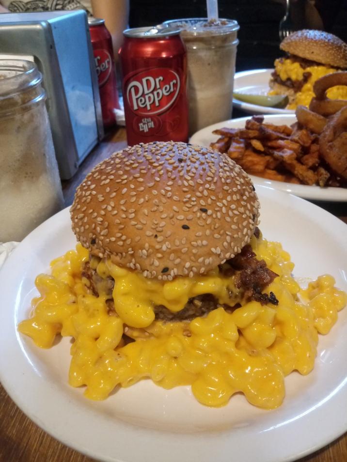 Gilmac Burger oozing mac and cheese