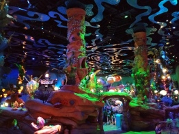 A picture of the inside neon lit dim Triton's Kingdom inside facilities.