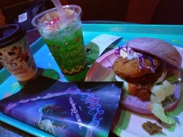 Cup of coffee, special Halloween Melon soda and Halloween seafood burger with disney villains to go burger bag