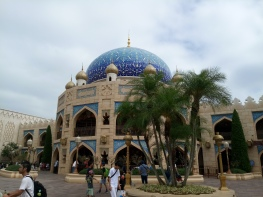 The Caravan Carousel, a covered carousel ride that is two stories beneath a beautiful blue dome