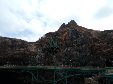 Walkways around the Mysterious island and a train sticking out of the side of the volcano