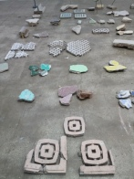 """Close up of Tanya Goel's """"Frescos"""": debris fragments of stone, cement, plaster and tiles collected from demolition sites across Delhi"""