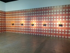 """Pio Abad's """"Oh! Oh! Oh! (A Universal History of Iniquity) of digital wallpaper and plastic perfume bottles"""