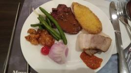 pork with a soybean sauce, steak, green beans, sweet and sour chicken, tempura sweet potato and a coconut dumpling